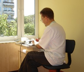 Head of NZOZ, Krzysztof Włochacz working at his office.
